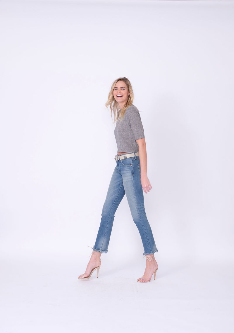 "Side View of Midheaven's Relaxed High-Rise Straight Leg Details: Second Model: 6' - Wearing 4"" Heels Rigid denim will relax with wear. Considering going down one size.  Rise: 10""