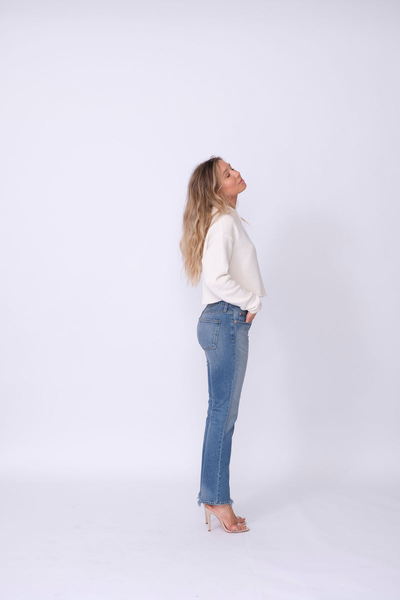 "Side View of Midheaven's Relaxed High-Rise Straight Leg Details: First Model: 5' 7"" - Wearing 4"" Heels Rigid denim will relax with wear. Considering going down one size.  Rise: 10""