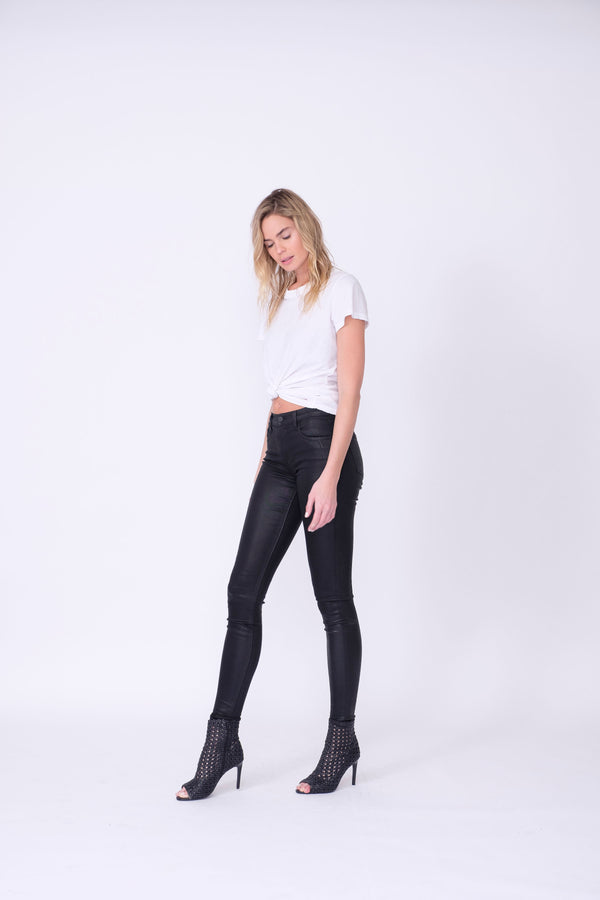 "Side View of Midheaven's High-Rise Black Coated Skinny   ITEM RUNS SMALL - CONSIDER SIZING UP ONE SIZE  Details: Model is 6' and is wearing 3"" heels.  Rise: 9.5""  Inseam: 30"" or 34"" (Please Choose Inseam Below)  Leg opening: 10""  Fabric Contents:  98% Cotton - 2% Elastane"