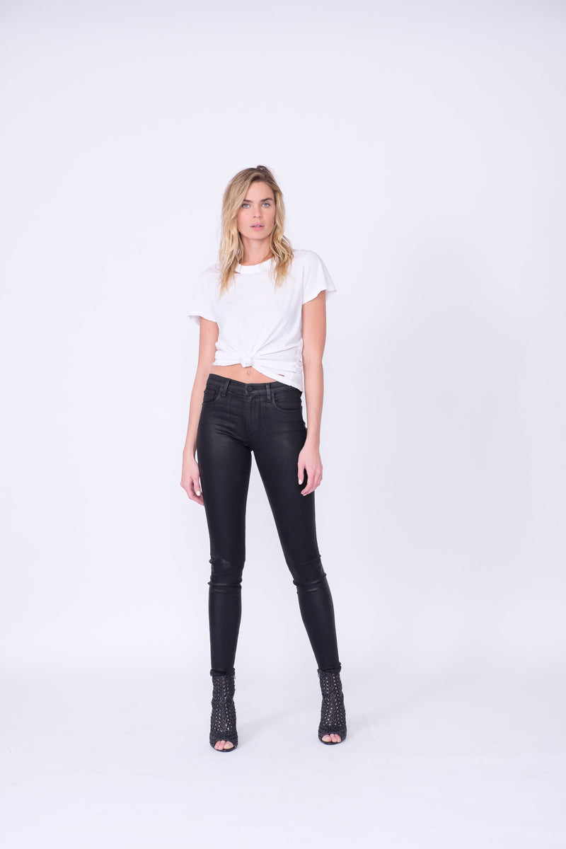 "Front View of Midheaven's High-Rise Black Coated Skinny   ITEM RUNS SMALL - CONSIDER SIZING UP ONE SIZE  Details: Model is 6' and is wearing 3"" heels.  Rise: 9.5""  Inseam: 30"" or 34"" (Please Choose Inseam Below)  Leg opening: 10""  Fabric Contents:  98% Cotton - 2% Elastane"