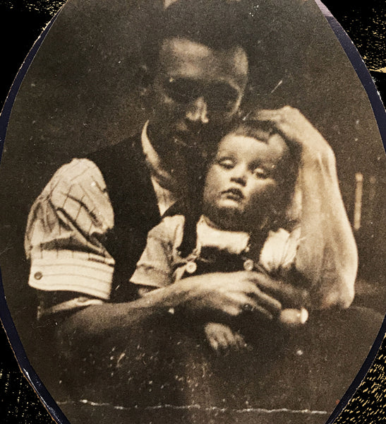 Baby picture of Garth Williams in the arms of his father