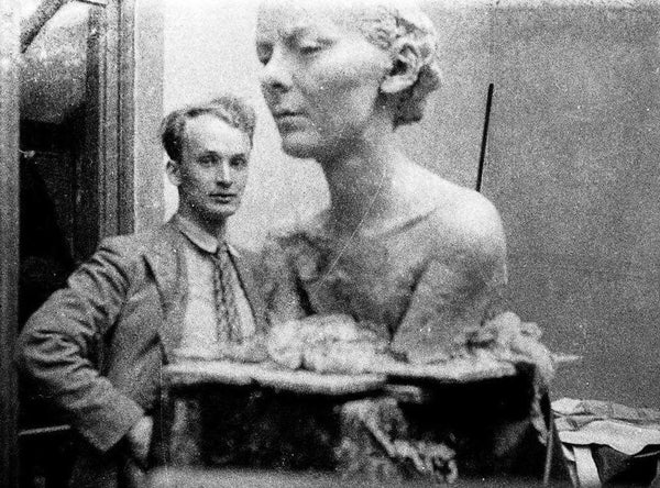Illustrator Garth Williams with his sculpture of a bust