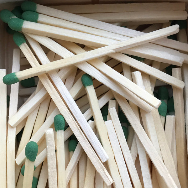 Matches with green heads