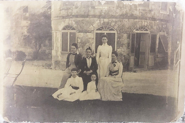 Vintage photo of sugar plantation family in front of estate house in Barbados