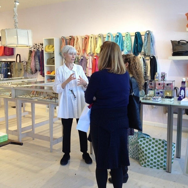 Paper Trail owner Serene Hastings chats with customers
