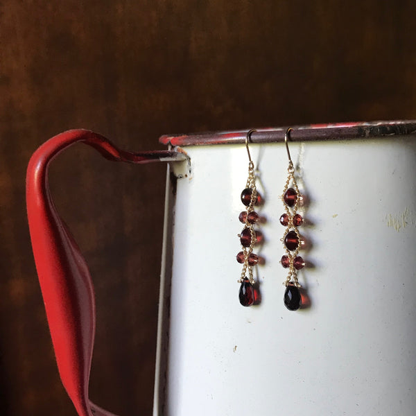 Garnet and gold Wave earrings by Estyn Hulbert
