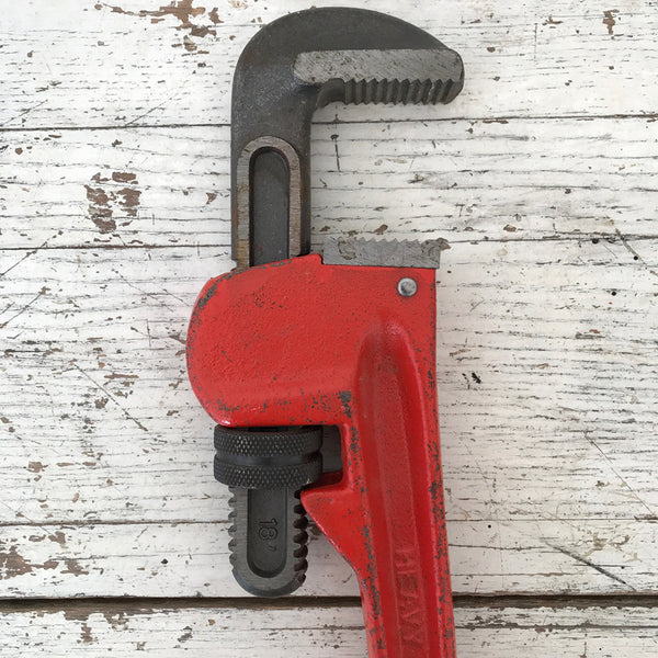Large red pipe wrench