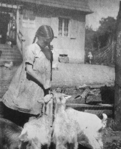 Gisela von Davidson on childhood farm with goats