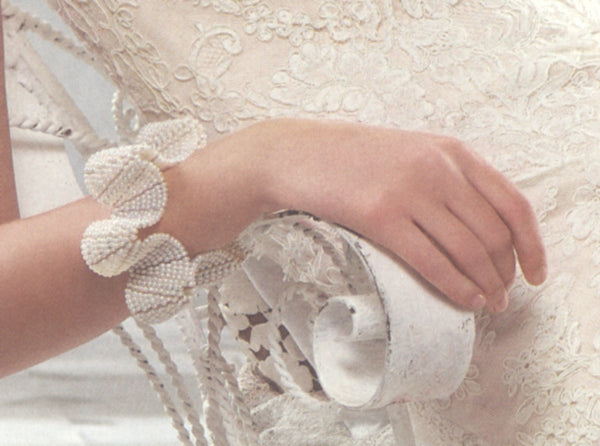 Detail of pearl Flower cuff by Estyn Hulbert in Martha Stewart Weddings