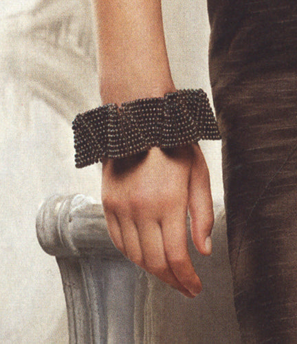 Detail of black pearl cuff bracelet, The Knot magazine