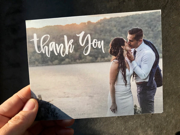 Wedding thank you note with photo of couple kissing