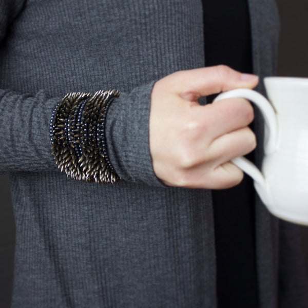 Two steel-toned bullet cuffs by Jessica Rose and Estyn Hulbert