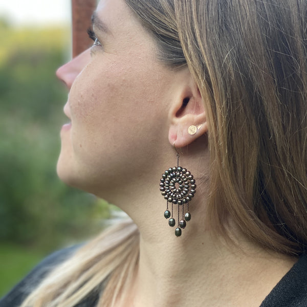 Model wearing black pearl Dreamcatcher earrings