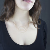 Model wearing gold Draped Chain necklace by Estyn Hulbert