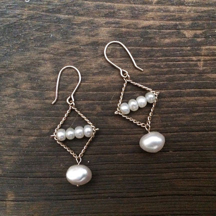 Hoard earrings in white pearls, designed by Estyn Hulbert