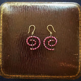 Small garnet spiral earrings