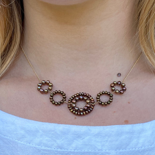Model wearing mixed brown pearl Daisy necklace