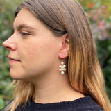 Model wearing small white pearl Kilim earrings