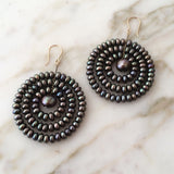 Sun earrings in black pearls, designed by Estyn Hulbert