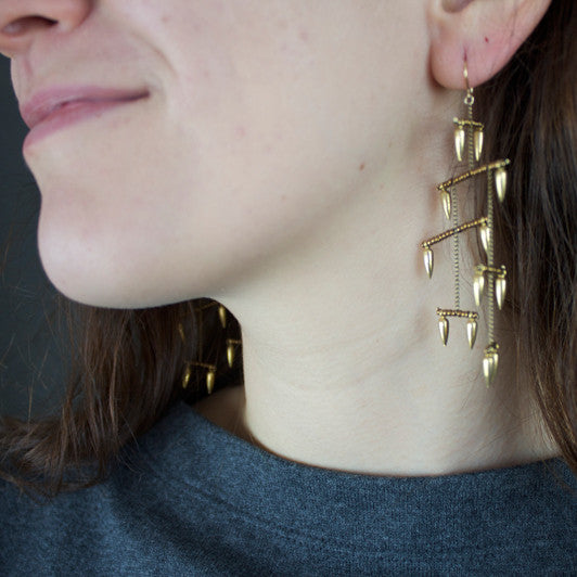 Gold Bullet La Donna earrings on model