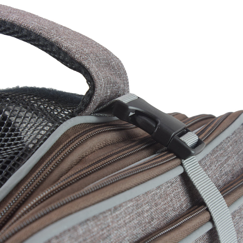 Zoomed view of adjustable strap with clip, zippers, and carry handle