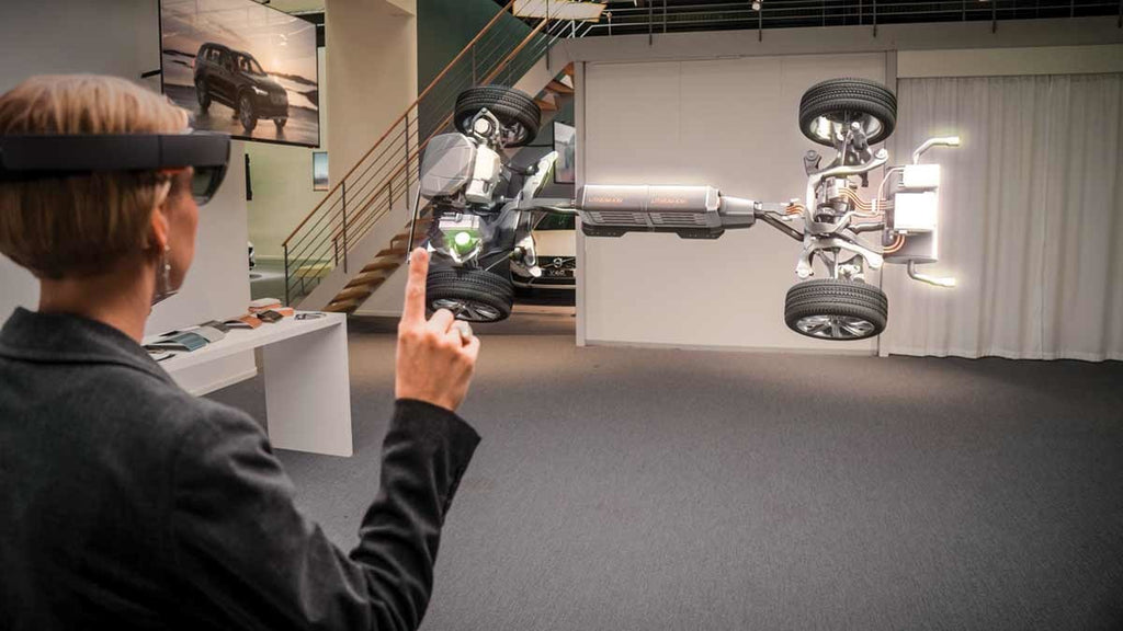 An AR showroom demo developed by Microsoft and Volvo provides an X-ray view of a car's engine and undercarriage.