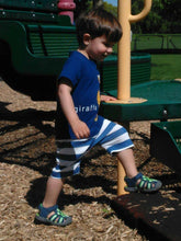 toddler boy in blue romper with back zipper side picture taken