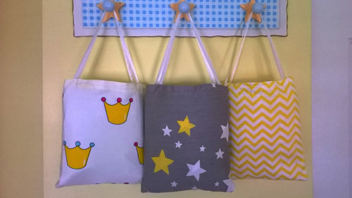 3 Fitted Crib Sheet with Ties hanging in cotton bags - white, gray and yellow