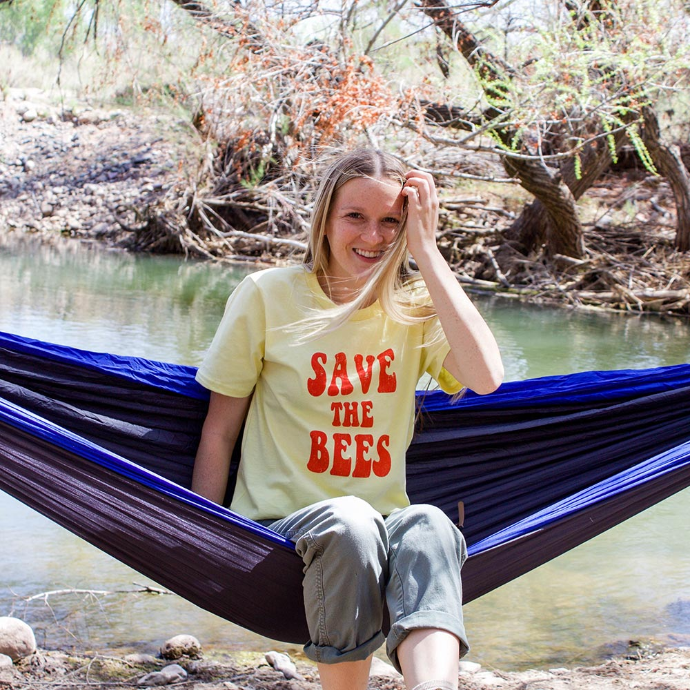 Female model wearing Honeycomb Hippie Save the Bees Organic Cotton T-shirt outdoors