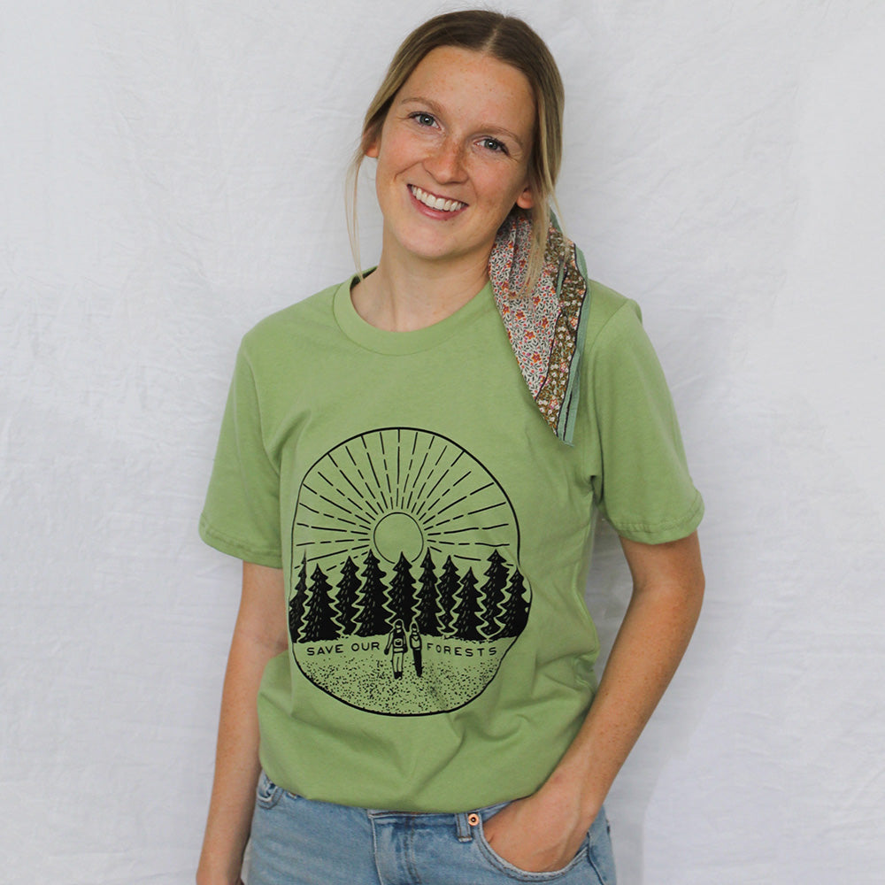 Female model wearing Honeycomb Hippie organic cotton Save our Forests shirt