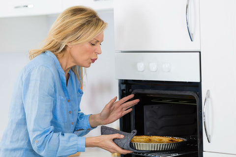 Woman burnt at oven