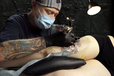 Woman getting tattoo care
