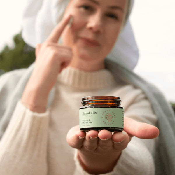 Five Natural Skincare Tips for Glowing Winter Skin image showing ManukaRx Clearing Face Cream being used by a woman after a shower.