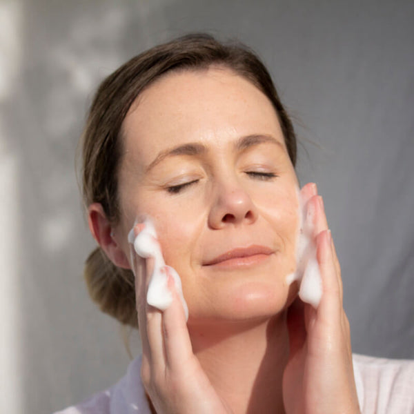 ManukaRx-East Cape Manuka Essential Oil Spring Clean Your Skincare Routine With Mānuka Oil image showing a woman with beautiful clear skin using ManukaRx Foaming Facial Wash with the antibacterial power of Manuka Oil.