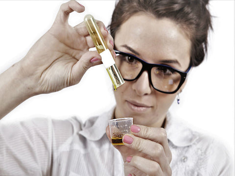 Scientist in lab with Manuka Oil