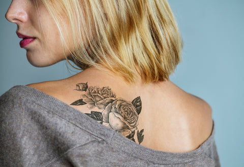 Rose tattoo on beautiful woman