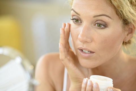 Woman using homemade moisturiser on face