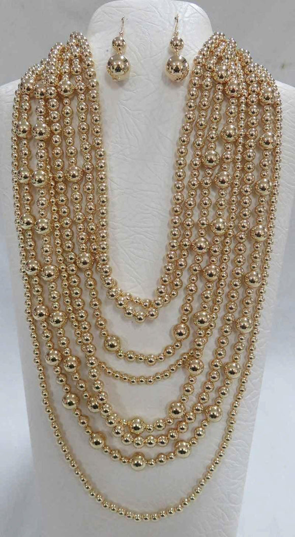 GOLD BALL MULTI LAYERED NECKLACE WITH EARRINGS ( 556 G )