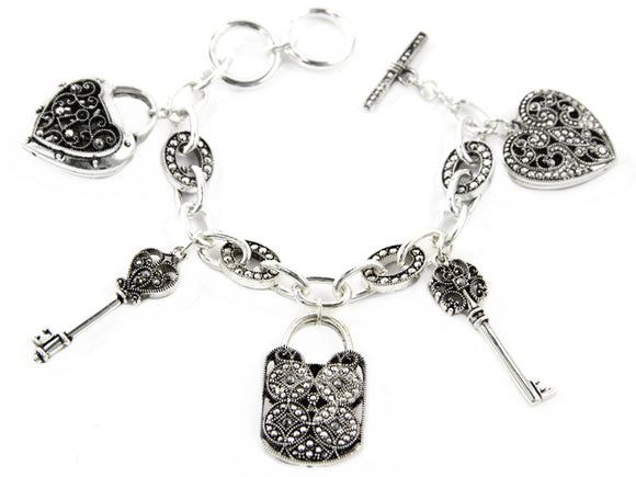 SILVER CHARM BRACELET WITH HEART PURSE AND KEY CHARMS ( 6459)