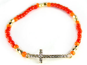 GOLD AND CORAL STRETCH BRACELET WITH GOLD CROSS ( 6573 )