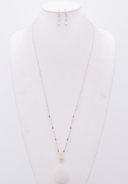 Long Gold Necklace with White Teardrop Stone Pendant