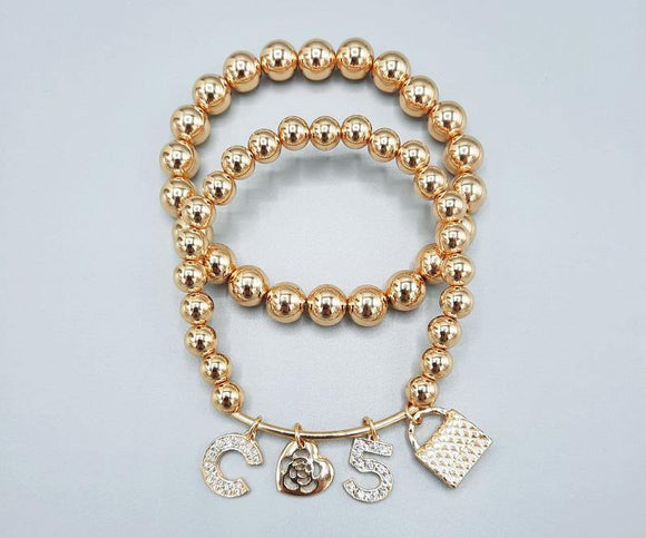 GOLD STRETCH BRACELETS C PURSE HEARTS CLEAR STONES ( 1216 GD )