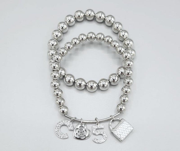 SILVER STRETCH BRACELETS C PURSE HEARTS CLEAR STONES ( 1216 RH )