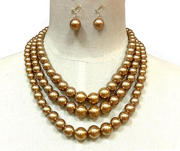 GOLD COLORED PEARL NECKLACE WITH MATCHING EARRINGS ( 30782 )