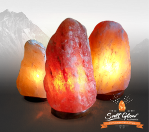Deep Amber, Coral, and pink Salt Lamps with Himalayan Mountains in background
