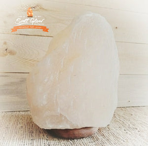 White rare Himalayan Salt Lamp on table