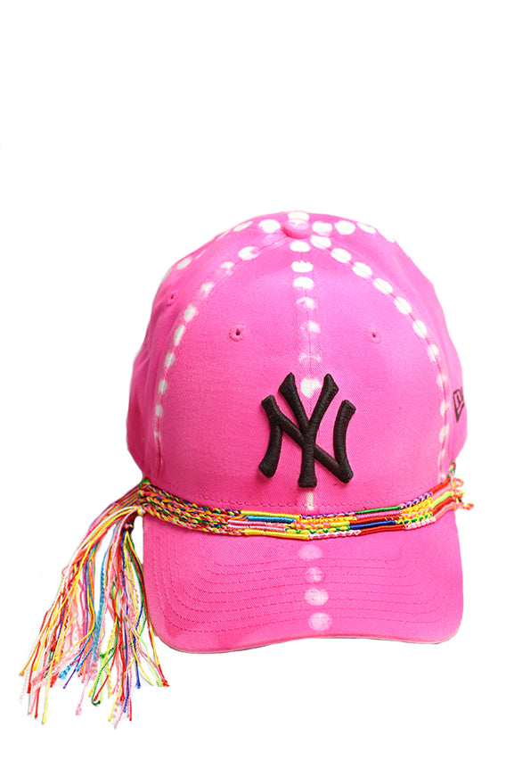 Pink cap with friendship bracelet