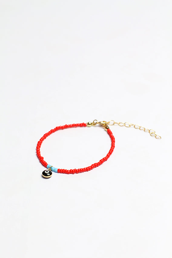 Red beads bracelet with black eye pendant