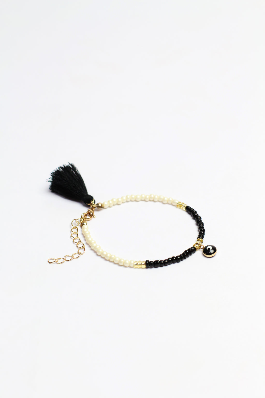 White/black beads bracelet w/ black eye pendant & black tassel