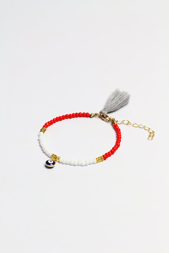 White/red beads bracelet with black eye pendant & gray tassel